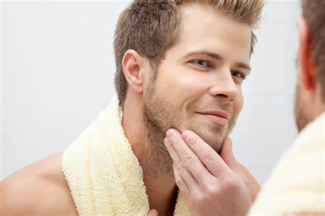 best skincare products for men - Pic of a man using skincare.